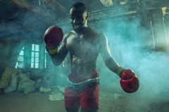 Hand of boxer over black background. Strength, attack and motion concept royalty free stock photos