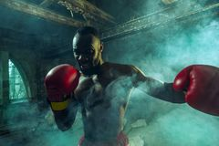 Hand of boxer over black background. Strength, attack and motion concept royalty free stock image