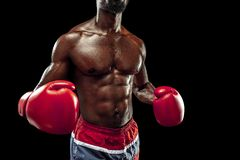Hand of boxer over black background. Strength, attack and motion concept stock images