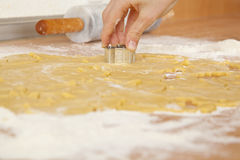 Hand of a boy cutting out cookies Stock Images
