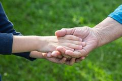 Hand of a boy in the hand of a grandmother Stock Photography