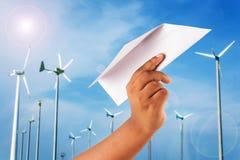 Hand boy play paper plane on wind turbine Stock Photos