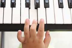 Hand of the boy. Playing piano Stock Image
