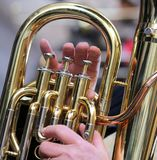 Hand of boy plays the trombone in the brass band Royalty Free Stock Photos