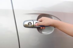 Hand boy pushing button of car handle Stock Images