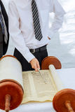 Hand of boy reading the Jewish Torah at Bar Mitzvah Stock Photography