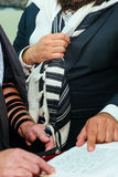 Hand of boy reading the Jewish Torah at Bar Mitzvah Royalty Free Stock Photos