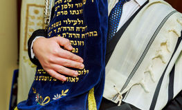 Hand of boy reading the Jewish Torah at Bar Mitzvah Royalty Free Stock Images