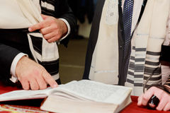 Hand of boy reading the Jewish Torah at Bar Mitzvah Royalty Free Stock Photo