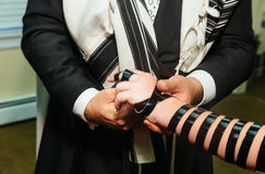 Hand of boy reading the Jewish Torah Bar Mitzvah Royalty Free Stock Photo