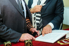 Hand of boy reading the Jewish Torah at Bar Mitzvah Royalty Free Stock Photography