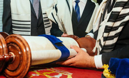 Hand of boy reading the Jewish Torah at Bar Mitzvah Stock Image