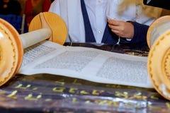 Hand of boy reading the Jewish Torah at Bar Mitzvah. Bar Mitzvah Torah reading Stock Photos