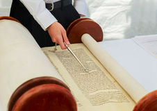 Hand of boy reading the Jewish Torah at Bar Mitzvah 5 SEPTEMBER 2016 USA Stock Image