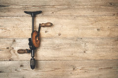 Hand brace drill on a wooden workbench Stock Images