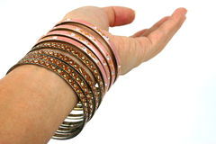 Hand with bracelets Stock Images