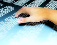 Hand braille. Man hand reading braille on metal sheet Royalty Free Stock Photo