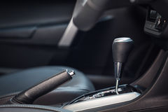 Hand brake in a new modern car. Close up Hand brake in a new modern car Royalty Free Stock Photos