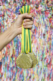 Hand of Brazilian Athlete with Medal Wish Ribbons Royalty Free Stock Photography