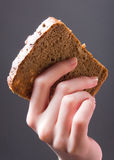 Hand with bread Royalty Free Stock Photos