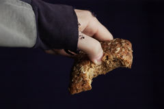 Hand with bread Stock Photography