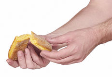 Hand breaking apart a bread Stock Photo