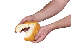 Hand breaking apart a bread Royalty Free Stock Images