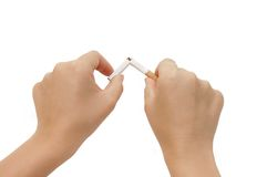 Hand Breaking a cigarette. NO SMOKING ! Stock Photo