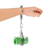 Hand with breaking handcuffs and money Royalty Free Stock Images