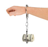 Hand with breaking handcuffs and money Stock Image