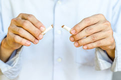 Hand breaking the last cigarette to stop smoking Royalty Free Stock Photography