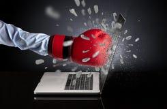 Hand breaks laptop screen. Strong male hand breaks laptop screenn stock image