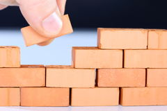 Hand and brick Royalty Free Stock Photography