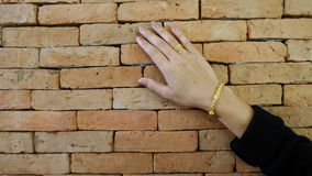 Hand on brick wall Royalty Free Stock Photography