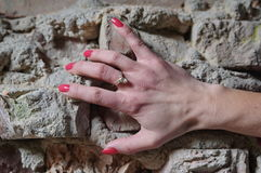 Hand on the brick wall Stock Photo