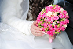 Hand of the bride on a bouquet Stock Images