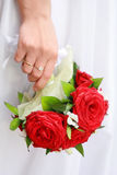 Hand of the bride with a bouquet Stock Images