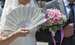 Hand of the bride with a fan Stock Images