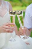 Hand the bride and groom with glasses of champagne Stock Photo
