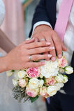 Hand of the bride and groom with rings for wedding bouquet Royalty Free Stock Photography