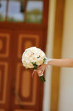 Hand of a bride holding  wedding bouquet of roses Royalty Free Stock Images