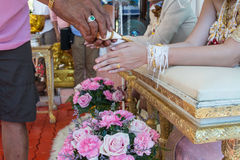 Hand of a bride receiving holy water from elders Stock Photo