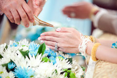 Hand of a bride receiving holy water from elders in thai culture Royalty Free Stock Photography