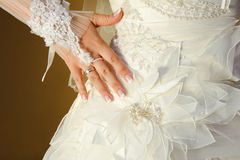 Hand of bride with a wedding ring on her dress. Wedding ring and her dress Royalty Free Stock Images