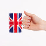 Hand with british cup Stock Photos