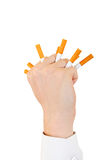Hand With Broken Cigarettes Stock Photography