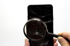 Hand with broken touch smartphone. Isolated on white background. The concept of mobile phone repair. Hand with broken touch smartphone. Isolated on white royalty free stock photos