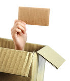 Hand with brown card out of box Royalty Free Stock Photo