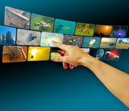Hand browsing images in touch screen virtual space Stock Image