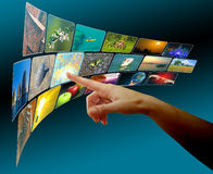 Hand browsing images in touch screen virtual space Stock Photography